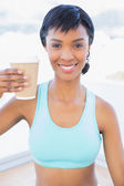 Cheerful black haired woman drinking coffee — Stock Photo