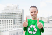 Content pretty environmental activist making thumbs up — Stock Photo