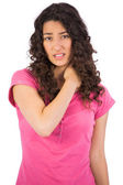 Young brunette with painful neck — Stock Photo