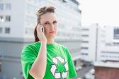 Environmental activist talking on the phone — Stock Photo
