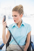 Furious stylish businesswoman shouting on the phone — Stock Photo