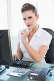 Thoughtful pretty businesswoman working on computer — Stock Photo