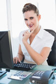 Smiling businesswoman working on computer — Stock Photo