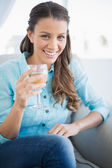 Happy woman holding glass of white wine — Stock Photo
