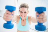 Happy woman wearing sportswear exercising with dumbbells — Stock Photo