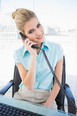 Smiling stylish businesswoman answering the phone — Stock Photo