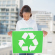 Stock Photo: Pretty volunteer womholding recycling sign