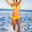 Attractive woman in bikini posing in the sea — Stock Photo