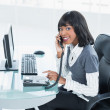 Smiling classy businesswoman answering the phone — Stock Photo #31551739