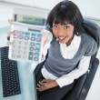 High angle view of smiling businesswoman showing calculator — Stock Photo