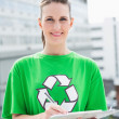 Stock Photo: Happy environmental activist holding clipboard