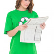 Stock Photo: Concentrated environmental activist reading newspaper