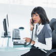 Stern classy businesswoman answering the phone — Stock Photo #31554889