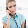 Serious stylish businesswoman on the phone — Stockfoto