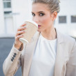 Gorgeous stylish businesswoman drinking coffee — Stock Photo
