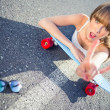 Cool skater girl doing rock and roll hand gesture — Stock Photo