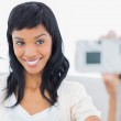 Natural black haired woman in white clothes taking a picture of herself — Stock Photo