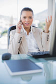 Offended sophisticated businesswoman on the phone — Stock Photo