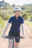 Happy woman with bike — Stock Photo