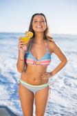 Cheerful attractive woman in bikini holding cocktail — Stock Photo
