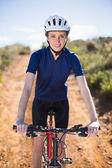Smiling woman on bike — Foto Stock
