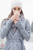 Pretty brunette with winter clothes on drinking coffee — Stock Photo