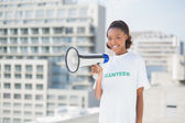 Happy volunteer woman holding megaphone — Stock Photo