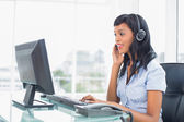 Concentrated operator answering a call — Stock Photo