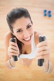 Fit smiling woman holding jump rope — Stock Photo
