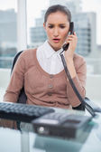 Furious businesswoman picking up the phone — Stock Photo