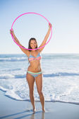 Attractive woman in bikini playing with hula hoop — Stock Photo
