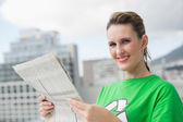 Environmental activist holding newspaper — Stock Photo