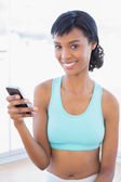 Content fit woman texting with her mobile phone — Stock Photo