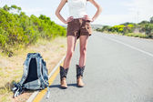 Backpacking woman on the roadside posing — Stock Photo