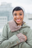 Lovely young model in winter clothes posing and looking at camera — Stock Photo