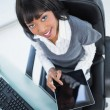 High angle view of cheerful businesswoman holding tablet — Stock Photo #31563651