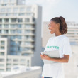 Cheerful volunteer woman holding clipboard — Stock Photo