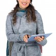 Smiling model wearing winter clothes holding her tablet — Stock Photo #31565681