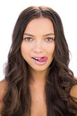 Cheeky woman sticking her tongue out — Stock Photo
