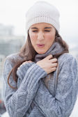 Shivering cute woman with winter clothes on posing — Stock Photo