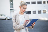 Relaxed stylish businesswoman scrolling on digital tablet — Stock Photo