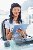 Cute businesswoman using a tablet pc — Foto de Stock