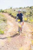 Smiling woman riding bike — Stock Photo