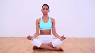 Calm woman meditating in lotus position — Stock Video