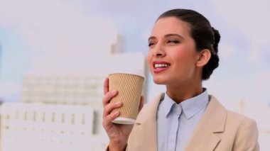 Delighted beautiful businesswoman enjoying coffee — Stock Video