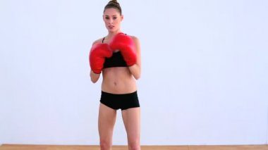 Dynamic woman boxing with red gloves — Stock Video