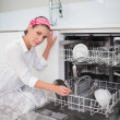 Serious charming woman using dish washer — Stock Photo #33397789