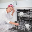 Serious charming woman using dish washer — Stock Photo