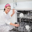 Cheerful charming woman using dish washer — Stok fotoğraf