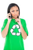 Thoughtful environmental activist making a phone call — Stock Photo